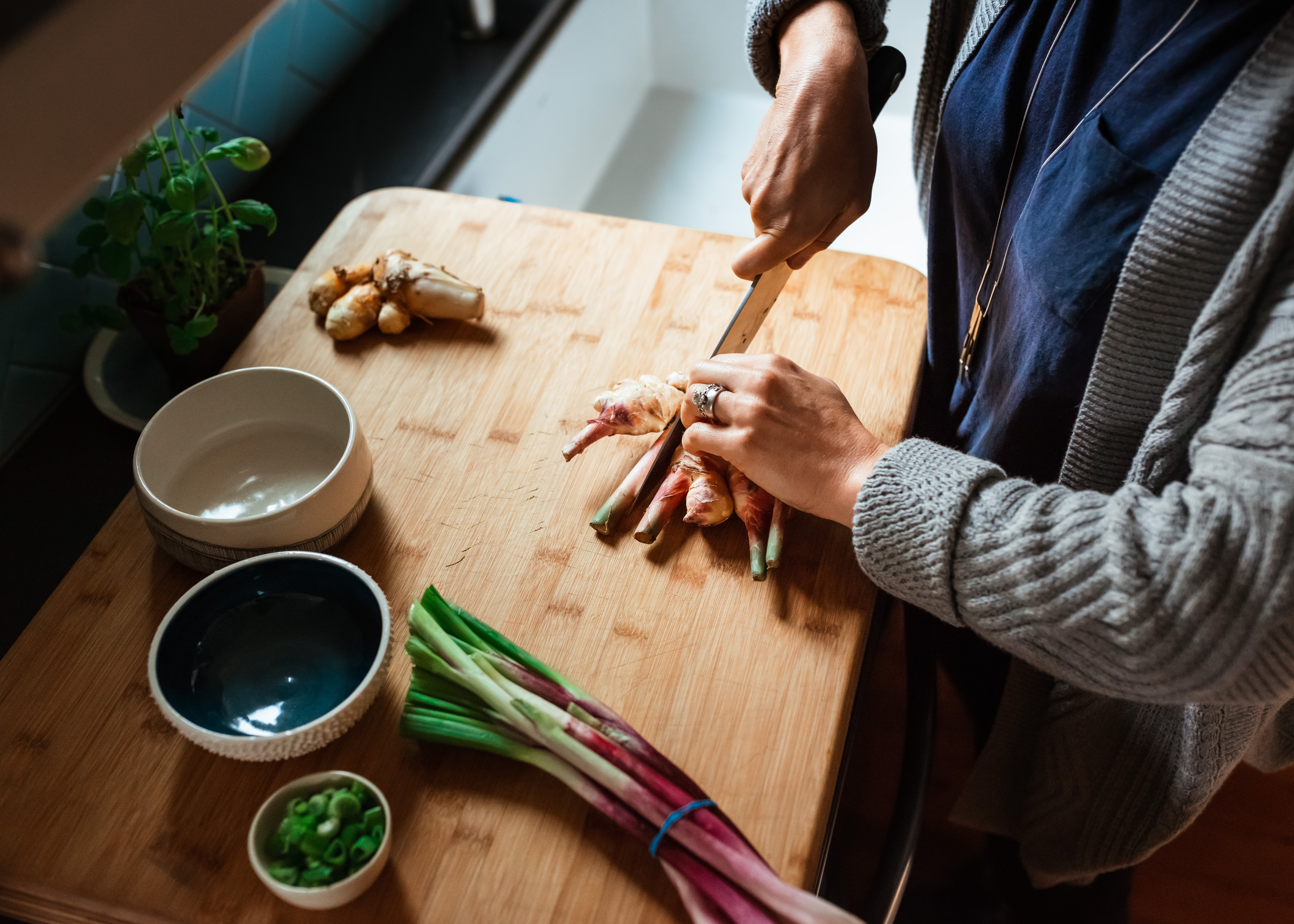 Candid photo of woman cutting vegetables
