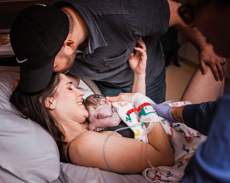 Beautiful birth photo of mother holding newborn baby